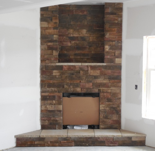 Brick corner fireplace - new home construction