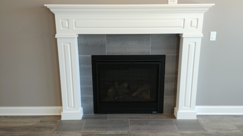 New home construction - White framed fireplace